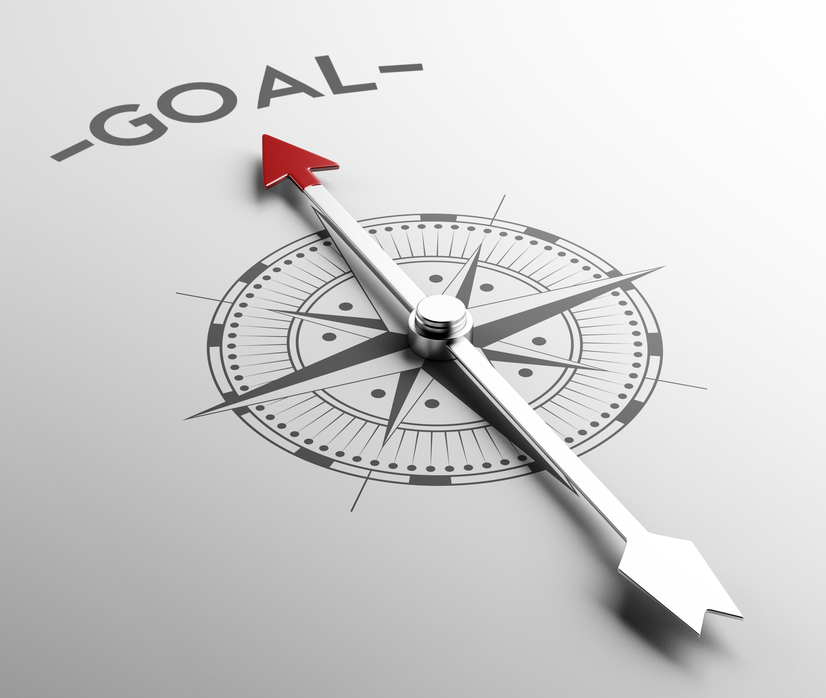 compass pointing to word goal